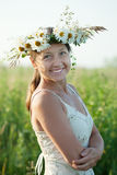 Mature woman in camomile chaplet. Outdoor portrait of mature woman in camomile chaplet royalty free stock image