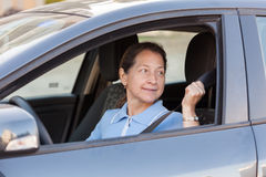 Mature woman  in  car. Royalty Free Stock Photography