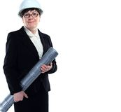 Mature woman carrying building plans Royalty Free Stock Photography
