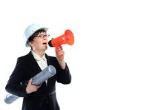 Mature woman carrying building plans and shout in megaphone Royalty Free Stock Photos