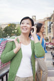 Mature Woman With Cell Phone In Shopping Mall Stock Photography