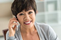 Mature woman on cellphone Stock Photos