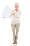 Mature woman chat box. Beautiful mature woman pointing at chat box isolated on white Stock Image