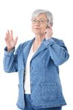 Mature woman chatting on mobile smiling Stock Image