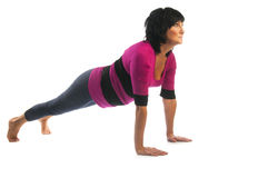 Mature woman in Chaturanga Dandasana yoga pose Stock Images