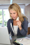 Mature woman checking medication composition on internet. Woman checking medicine prescription on internet Stock Photos