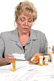 Mature woman checking prescription Stock Image