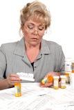 Mature woman checking prescription Stock Image