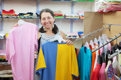 Mature woman  chooses clothes Stock Image