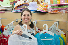 Mature woman  chooses dress Stock Photo