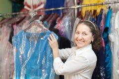 Mature woman chooses  dress at  shop Stock Photo