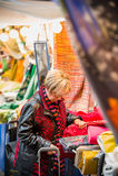 Mature woman choosing appropriate texttile Stock Photos