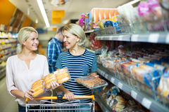 Mature woman choosing pastry in supermarket Royalty Free Stock Photos