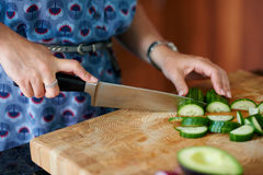 Mature woman chopping vegetables Stock Image
