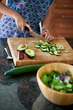 Mature woman chopping vegetables Royalty Free Stock Photography