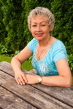 Mature woman in a city park Stock Image