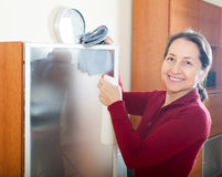 Mature woman cleaning  glass Royalty Free Stock Photo