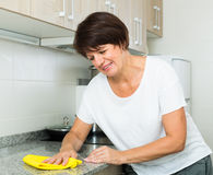 Mature woman cleaning Stock Photo