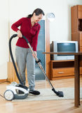 Mature woman cleaning  room Stock Photo