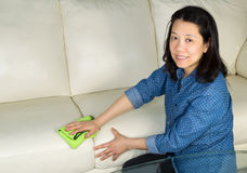 Mature woman cleaning Sofa with Microfiber Rag Royalty Free Stock Photos