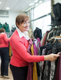Mature woman  in   clothing store. Royalty Free Stock Photography