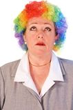Mature woman in clown wig. Self-pittying mature woman in colorful clown wig Stock Photography