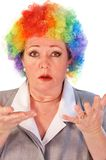 Mature woman in clown wig Stock Images