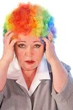 Mature woman in clown wig Royalty Free Stock Image
