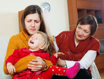 Mature woman comforting adult daughter with crying baby stock photo