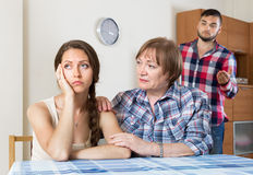 Mature woman comforting sullen daughter Stock Images