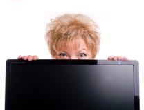 Mature woman and computer Royalty Free Stock Photos