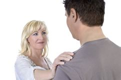 Mature woman consoling her husband Stock Image