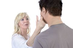 Mature woman consoling her husband Royalty Free Stock Image