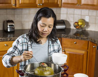 Mature Woman Cooking Winter Melon at home Stock Photo