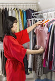 Mature woman coordinating her Clothes Royalty Free Stock Image