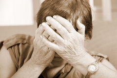 Mature woman covering her face Royalty Free Stock Photography