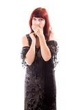 Mature woman covering mouth with her hand Stock Images