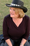 Mature Woman In Cowboy Hat Royalty Free Stock Images