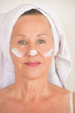 Mature Woman with cream on face Royalty Free Stock Photography