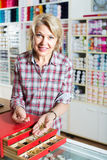 Mature woman customer in sewing store Royalty Free Stock Images