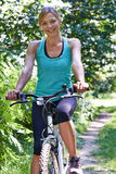 Portrait Of Mature Woman On Cycle Ride In Countryside Stock Image