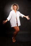 Mature  woman dancing against black background Royalty Free Stock Photography