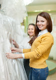 Mature woman  with daughter chooses white gown Royalty Free Stock Photos