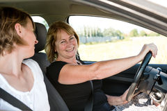 Mature woman with daughter driving car Stock Photography