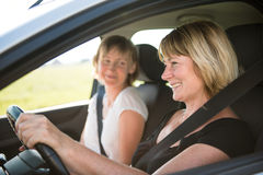 Mature woman with daughter driving car Royalty Free Stock Photo