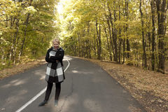 Mature woman on a deserted road Stock Image
