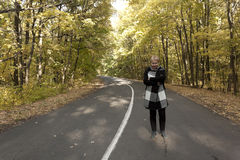 Mature woman on a deserted road Royalty Free Stock Photo