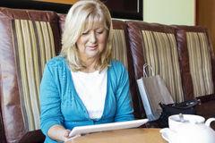 Mature woman with digital tablet Stock Image