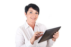 Mature woman with digital tablet. Picture of a smiling woman with digital tablet Royalty Free Stock Photo