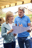 Mature Woman Discusses Plan With Landscape Gardener Stock Image